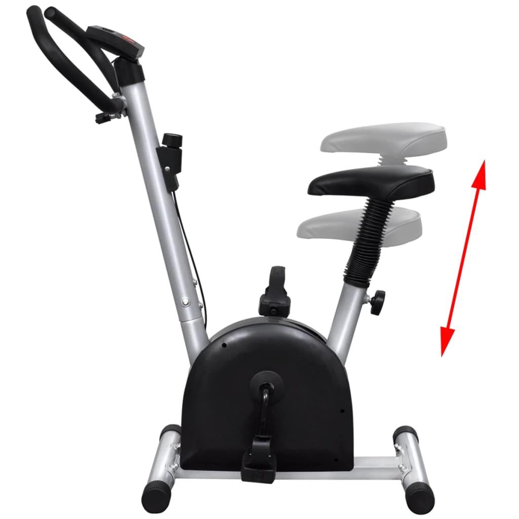 što jamči udoban trening. Tipka za otpor + / - na biciklu omogućuje stezanje pojasa kako bi vježbanje bilo intenzivnije. Opremljen je protukliznim pedalama i trakama za pedale.